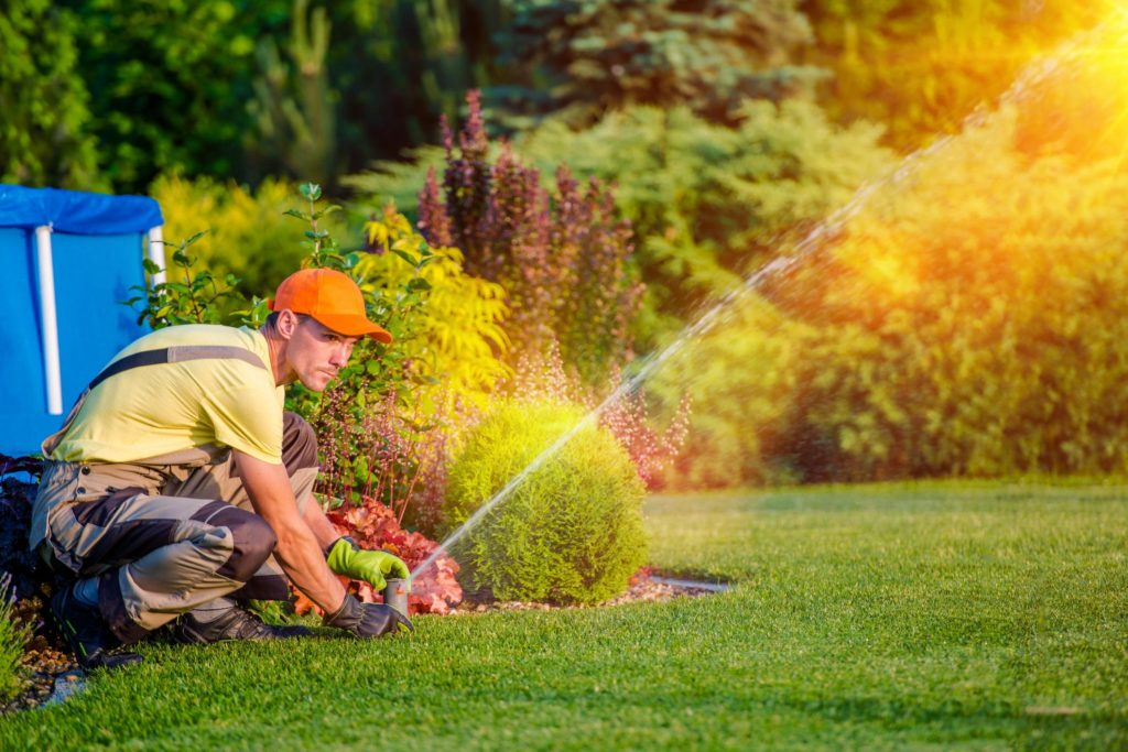 landscaper landscaping doing sprinkler installation